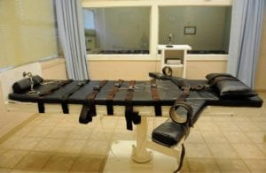 A bed with large straps is pictured inside an execution chamber in a Louisianna prison.