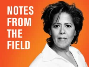 The headshot of Anna Deavere Smith is pictured in front of an orange background with the words Notes from the field to the left of her face
