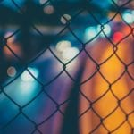 View through a chainlink fence at night